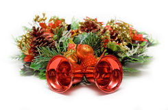 Cristmas bells. Red cristmas bells in wreath isolated on white background Stock Photography