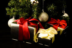 Cristmas box under the tree Royalty Free Stock Photography
