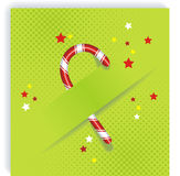 Cristmas caandy cane on green background Royalty Free Stock Photos