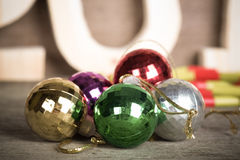 Cristmas colored balls on old wooden board with blured backgroun Royalty Free Stock Image