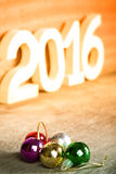 Cristmas colored balls on old wooden board with blured backgroun Royalty Free Stock Photography
