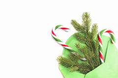 Cristmas composition. Green envelope, fir tree branch and candy canes on white background. Top view. Flat lay Royalty Free Stock Photos