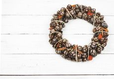 Cristmas cone wreath on white wooden background Stock Photo