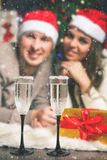 Cristmas couple young near decorated Christmas tree celebrating New Year royalty free stock images