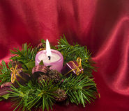 Cristmas decoration with a candle on red Stock Images