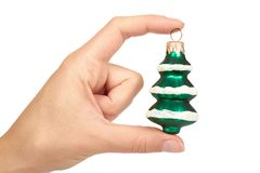 Cristmas decoration, ceramic green tree in hand isolated on white background. New Year object.  Stock Photography