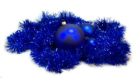Cristmas decorations isolated. Blue cristmas decorations - garlands and spheres isolated Stock Images