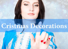 Cristmas decorations written on virtual screen. concept of celebratory technology in internet and networking. woman in Stock Photography