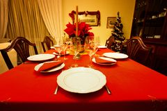 Cristmas dining table. Christmas dining table with cozy warm mood Royalty Free Stock Images