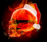 Cristmas fire skull. Beautiful fire skull with Christmas hat Royalty Free Stock Photo