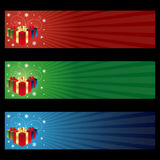 Cristmas gift banners. Set of three horizontal banners for Christmas with gift boxes.Isolated on black background.EPS file available Royalty Free Stock Images