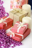 Cristmas gift, glassbeads and candle Royalty Free Stock Image