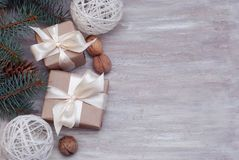 Cristmas Gift Present Brown Box with, Fir Branches, Nuts, on Wooden Background with Copy Space for Text. Cristmas Gift Present Brown Box with, Fir Royalty Free Stock Photography