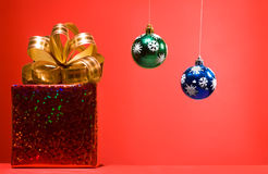 Cristmas gift red box with golden bow Royalty Free Stock Image