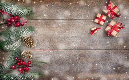 Cristmas gift on wood, snow Royalty Free Stock Photography