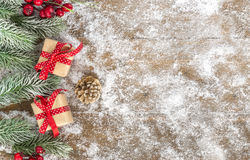 Cristmas gift on wood, snow Royalty Free Stock Photos