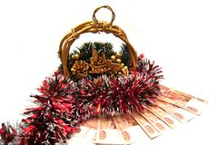 Cristmas gold basket with tinsel Royalty Free Stock Images
