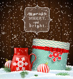 Cristmas greeting card with giftbox and red teacup Stock Photos