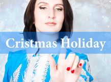 Cristmas holiday written on virtual screen. concept of celebratory technology in internet and networking. woman in Stock Photo