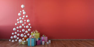 Cristmas interior with white balls, red wall mock up. Christmas decoration and gifts with white balls christmas tree, red wall, empty room, wooden floor, mock up Stock Image