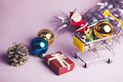 Cristmas  items. New year gift boxes in shopping cart on pink background Stock Image