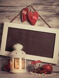 Cristmas lantern. With board for greetings over shabby wooden wall Stock Images