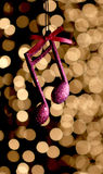 Cristmas music note decoration in front of a bokeh lights royalty free stock images