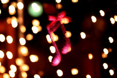 Cristmas music note decoration in front of a bokeh lights. Picture of a cristmas music note decoration in front of a bokeh lights, movement blurr stock photos