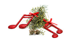 Cristmas music notes decoration on a tree branch stock images