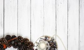 Cristmas wreath on white wooden background. Royalty Free Stock Photography