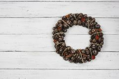 Cristmas cone wreath on white wooden background Royalty Free Stock Photography