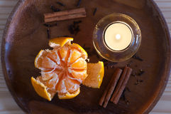 Cristmas orange, candle and spices Royalty Free Stock Photos