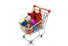 Cristmas ornaments shopping. Isolated shopping cart full of christmas ornaments Royalty Free Stock Images
