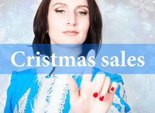 Cristmas sale written on virtual screen. concept of celebratory technology in internet and networking. woman in cristmas Royalty Free Stock Photo