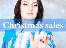 Cristmas sale written on virtual screen. concept of celebratory technology in internet and networking. woman in cristmas Stock Images