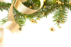 Cristmas seasonal background with spruce and beads. Cristmas seasonal background with spruce and golden beads isolated Royalty Free Stock Photos
