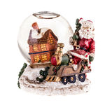 Cristmas Snow globe. A christmas themed snow globe with a house and a santa figurine isolated over white Royalty Free Stock Images