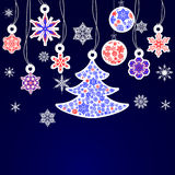 Cristmas snowflake and fir tree. On blue background Royalty Free Stock Photos