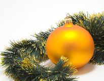 Cristmas sphere. Gold christmas sphere and garland Royalty Free Stock Photos