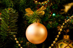 Christmas tree and ball. Hanging ball ant chaplet on Christmas tree Royalty Free Stock Photos