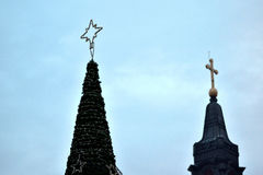Cristmas tree with a church in the background Stock Photo