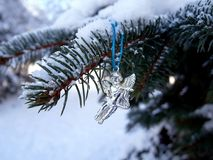 Cristmas tree toy angel under the snow on a spruce branch. Winter cristmas tree toy angel spruce snow white branches trees cold trees landscape nature plant Royalty Free Stock Image