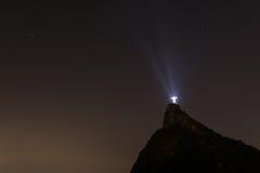 Cristo el redentor en la noche Fotos de archivo