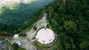 Cristo el redentor en Pico Isabel de Torres Foto de archivo