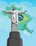 Cristo la estatua del redentor con la bandera del Brasil Fotos de archivo libres de regalías