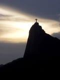 Cristo y puesta del sol Imagen de archivo