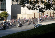 Critcal Mass bikers travel down 3rd street in mass Stock Photo
