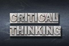 Critical thinking den. Critical thinking phrase made from metallic letterpress on dark jeans background stock image