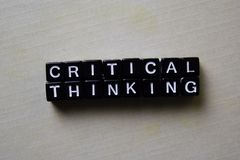 Critical Thinking on wooden blocks. Business and inspiration concept stock photography
