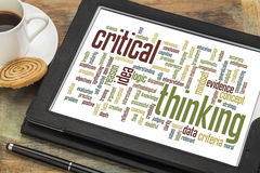 Critical thinking word cloud. On a digital tablet with a cup of coffee royalty free stock photography